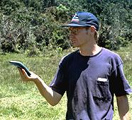 Student holding GPS unit